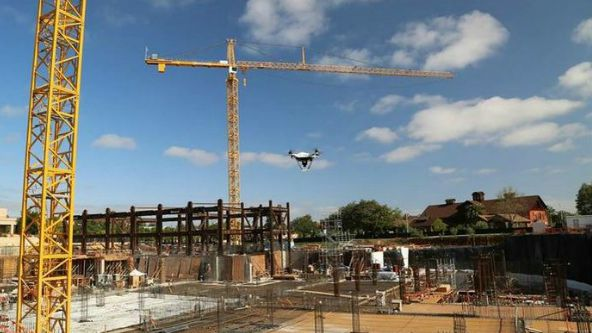 drone flies over BART project construction site