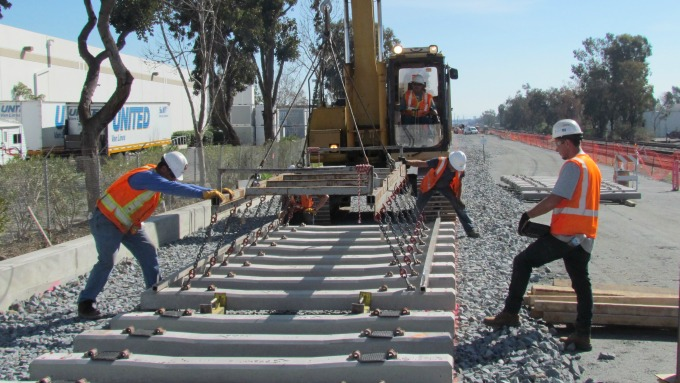 crews laying new BART track