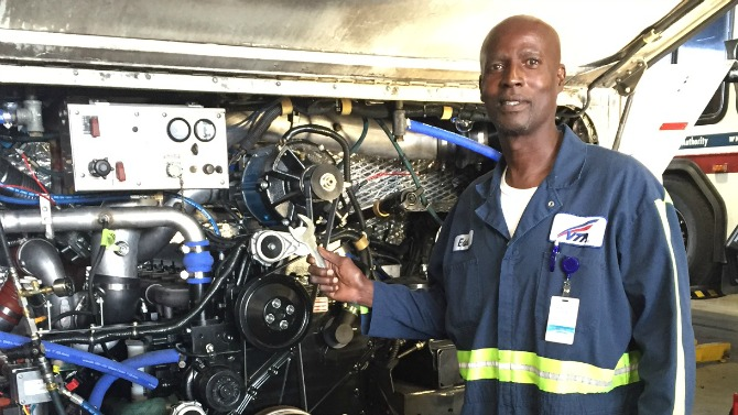 Eddie Nunley works on repairing a VTA bus.