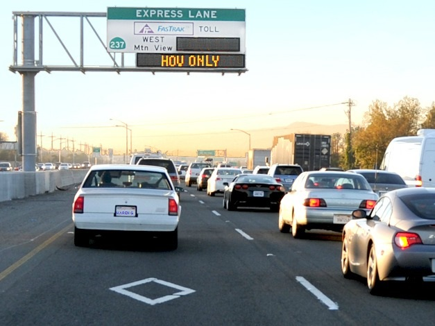a car on the express lane during HOV ONLY mode