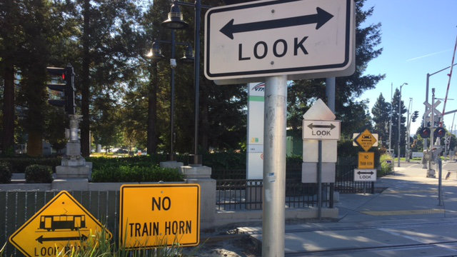 light rail crossing with warning signs