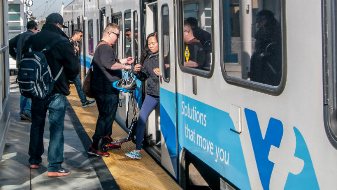 People boarding VTA light rail