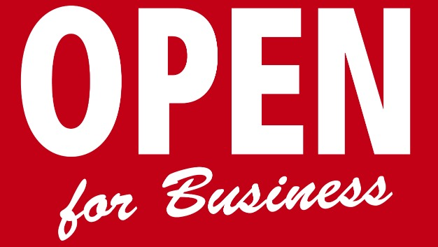 "sign that reads ""open for business"""