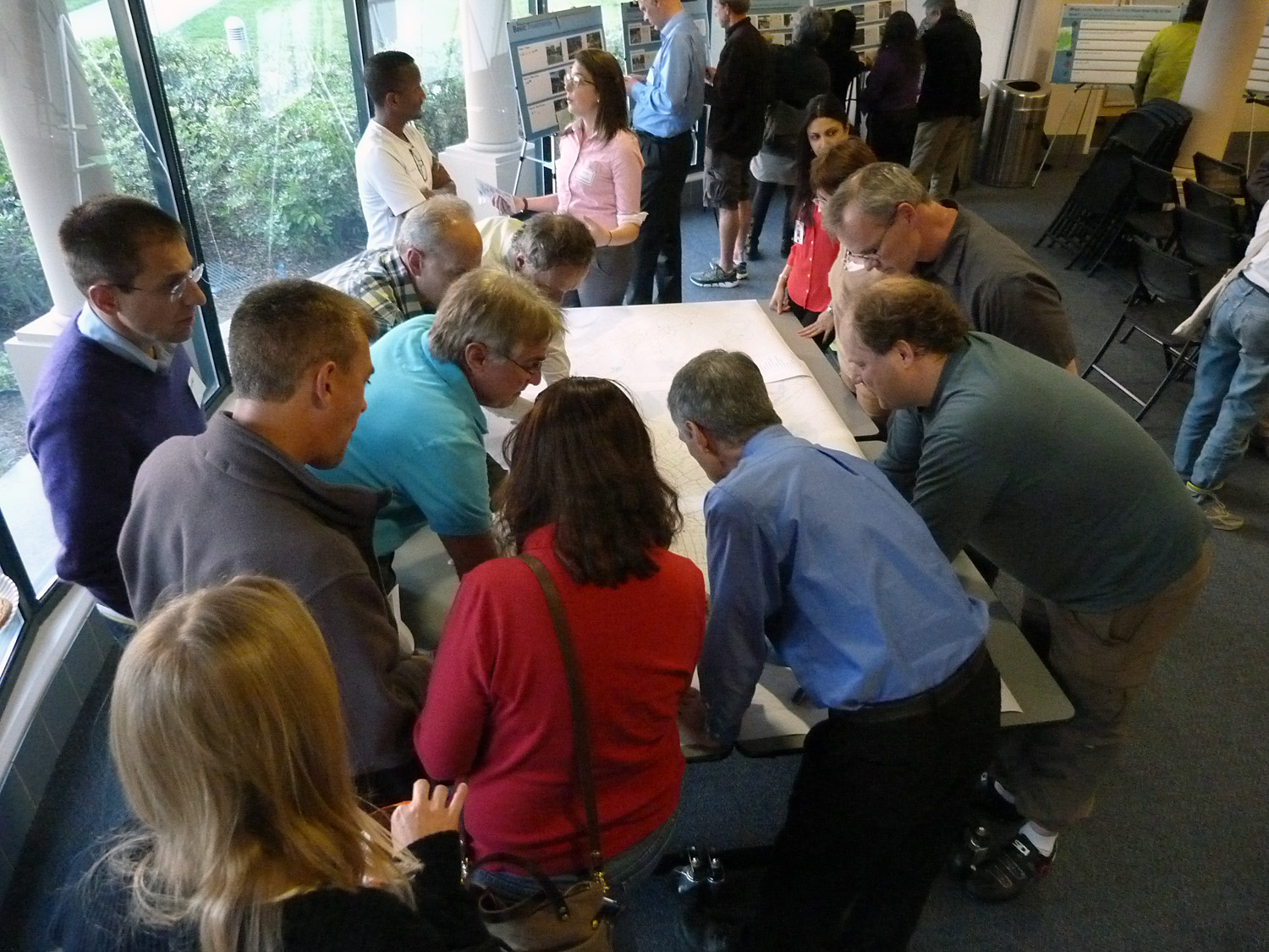 community members gathered around a county map providing feedback on bicycle facilities