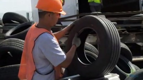 man holding a tire
