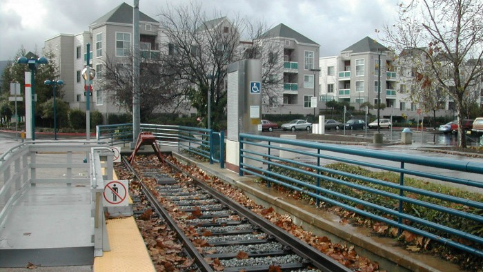 light rail tracks and apartments