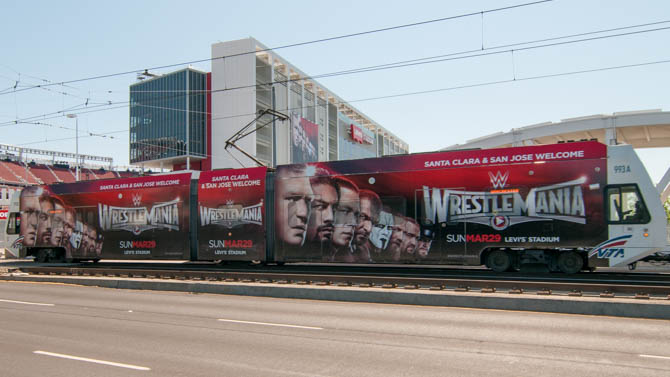WrestleMania themed light rail train in front of Levi's Stadium