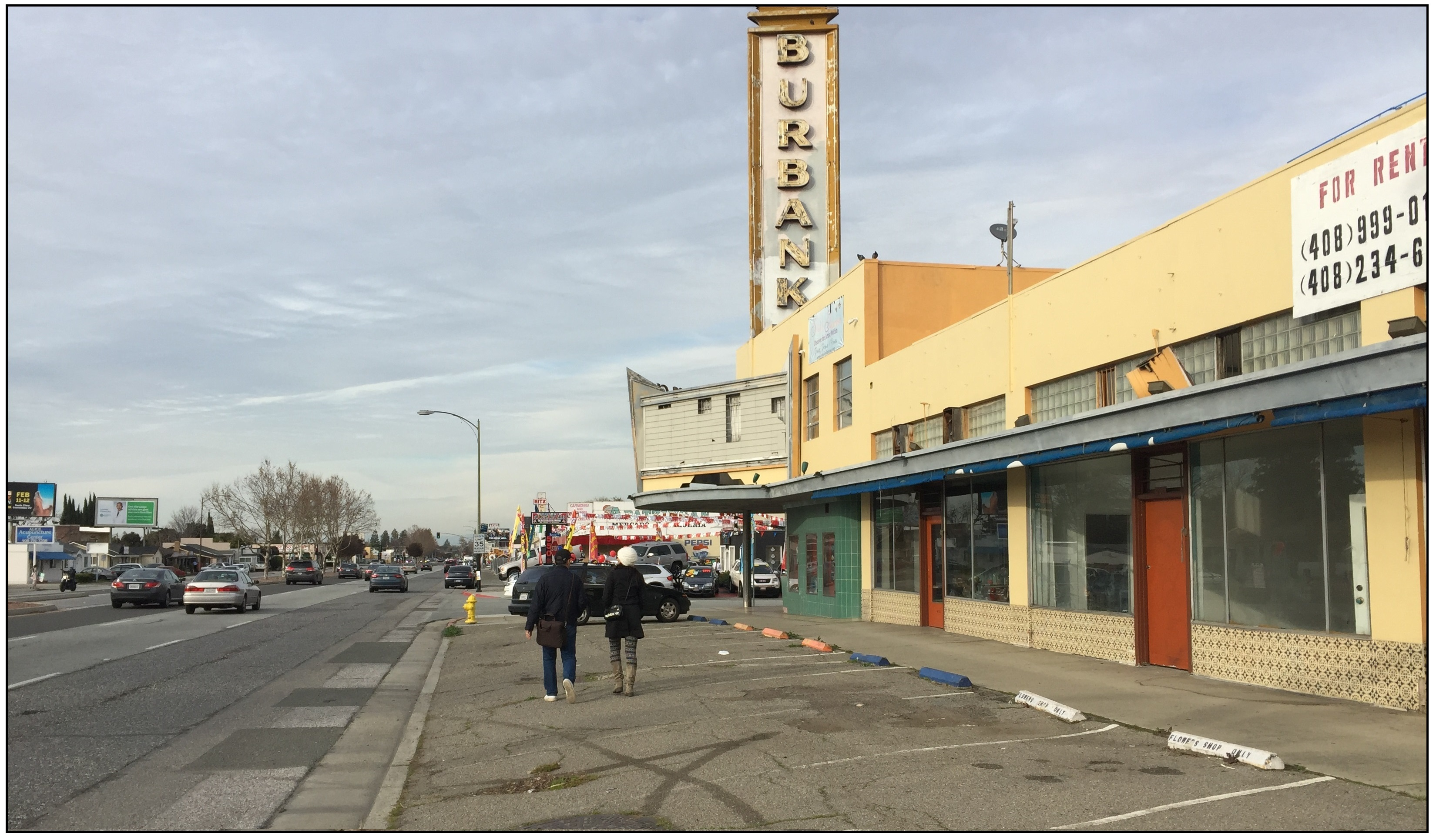 Burbank Theater, San Jose (no sidewalk for pedestrians, walking in the parking spaces in front of building)