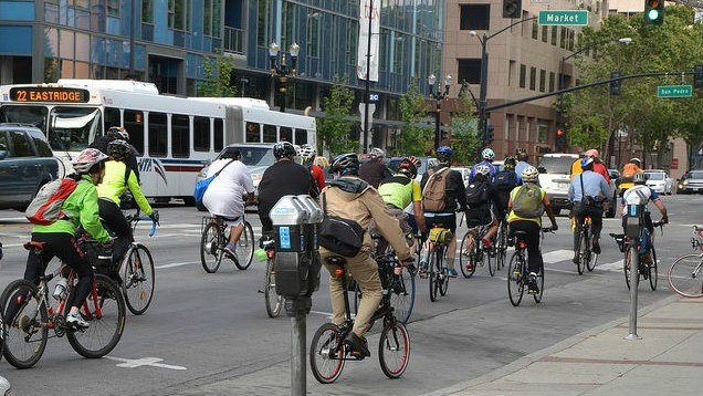 bicyclists with bus