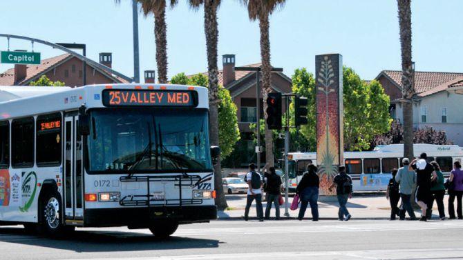 People walking near VTA bus at Alum Rock transit center