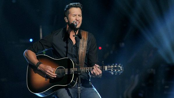 Luke Bryan playing guitar and singing